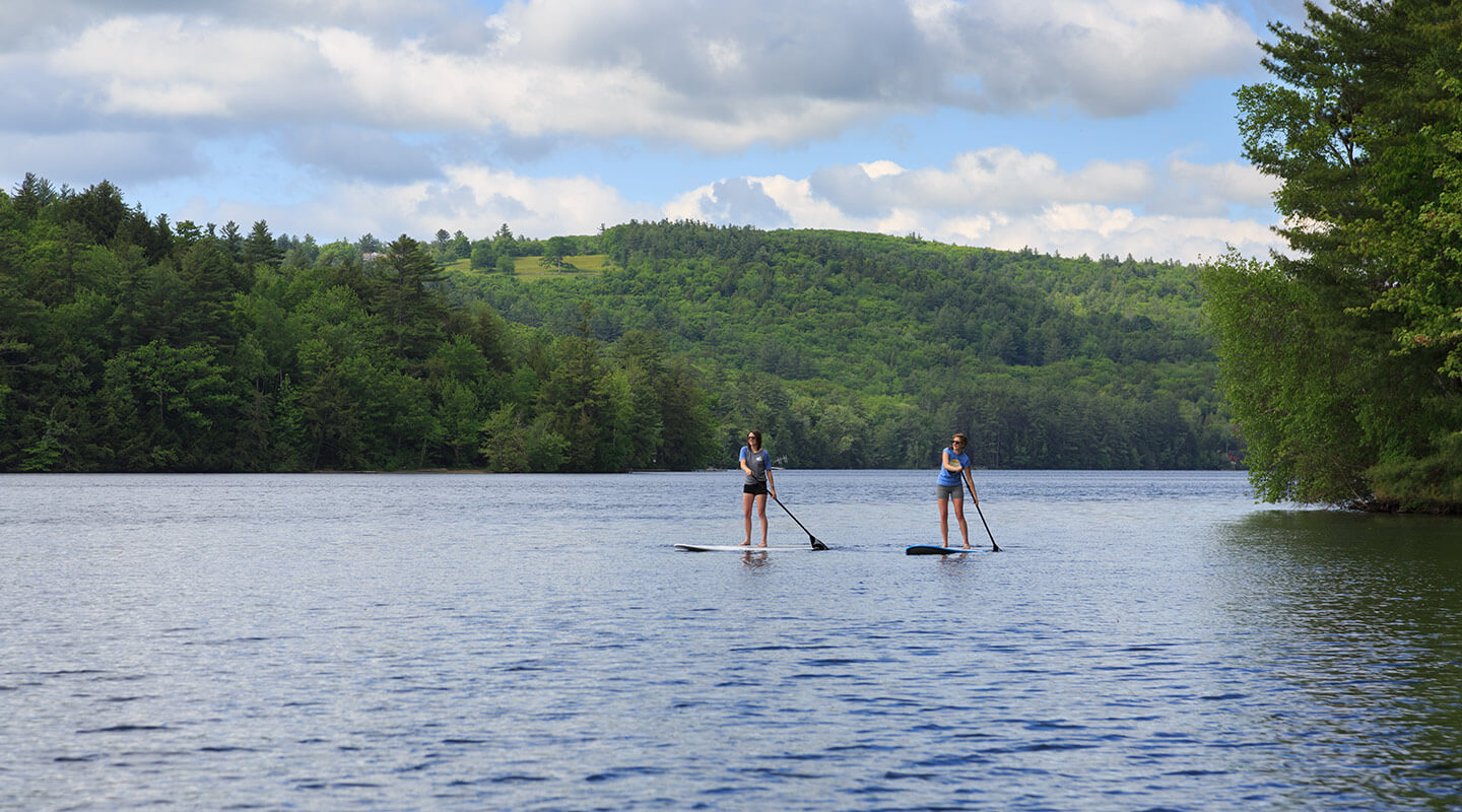 Stand up paddle boarding on a lakefront New Hampshire vacation