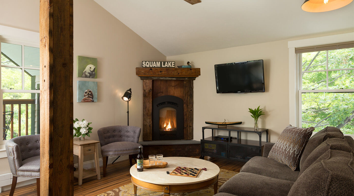 Inviting fireplace and sitting area at our inn on Squam Lake
