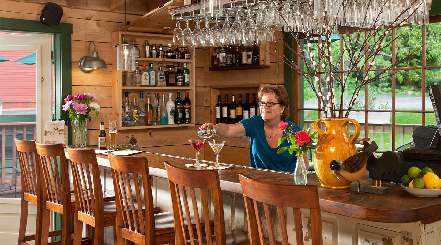 Bartender serving up fresh cocktails at Squam Lake Inn Kitchen and Bar