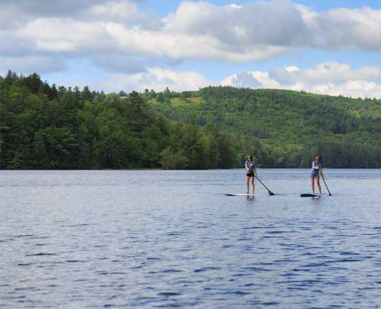 Paddleboarding at our New Hampshire Bed and Breakfast near Holderness