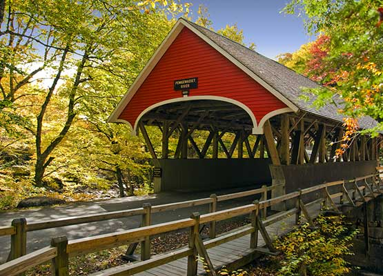Covered bridge surrounded by New Hampshire fall foliage