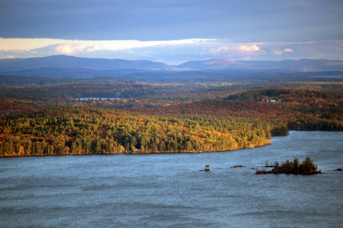 Squam Lake surrounded by fall foliage