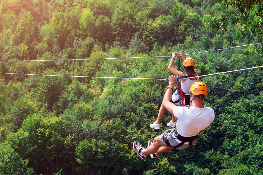 Couple ziplining at Squam Lake, New Hampshire
