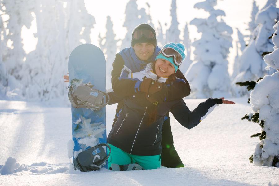 Couple Snowboarding in New Hampshire - Ski Slopes