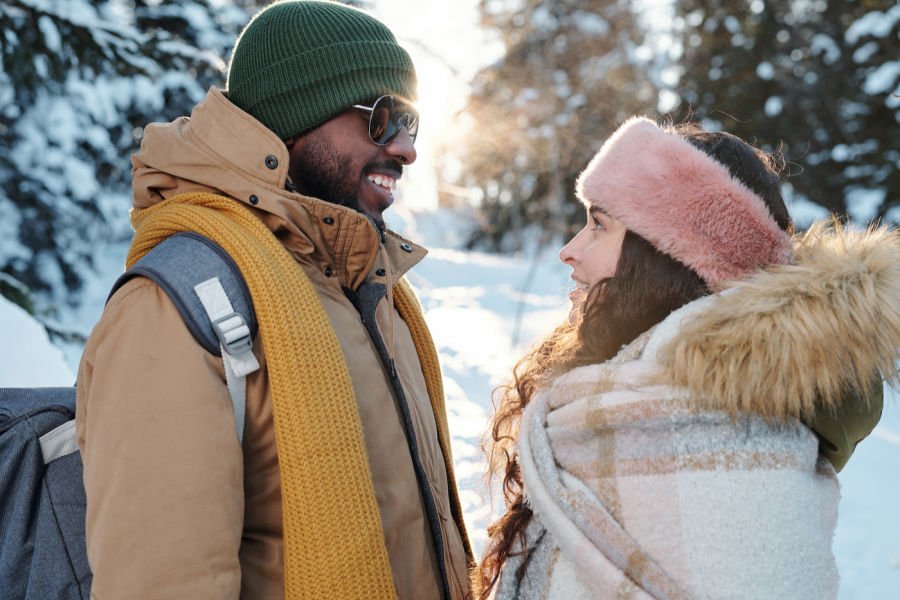 Couple smiling at each other in New Hampshire in winter