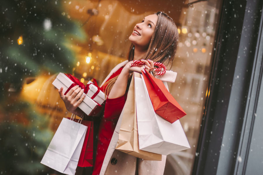Christmas Shopping in New Hampshire - Woman Happy Shopping with Bags